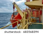 davits holding red lifeboat on... | Shutterstock . vector #683568394