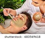 mud facial mask of man in spa...   Shutterstock . vector #683569618