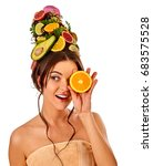 Small photo of Hair and facial mask from fresh fruits for woman concept. Girl holds halves of grapefruit and avocado for homemade organic skin therapy on isolated. She closes the eye half an orange.