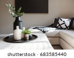 Small photo of Black accent decor in a luxury family living room