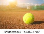 yellow tennis ball on a clay... | Shutterstock . vector #683634700