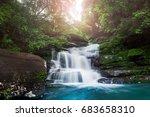 waterfall hidden in the... | Shutterstock . vector #683658310