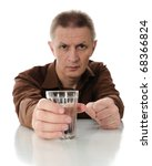 The middle-aged man with glass with water or alcohol. - stock photo
