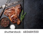 grilled t bone steak on stone... | Shutterstock . vector #683684500