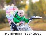 baby in stroller on a walk in...   Shutterstock . vector #683718010