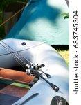 spinning reel for fishing on... | Shutterstock . vector #683745304