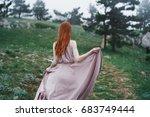 beautiful young woman in a long ...   Shutterstock . vector #683749444