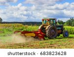 Small Tractor Working In The...