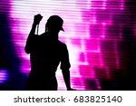 silhouette of an artist singing ... | Shutterstock . vector #683825140