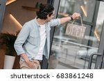 young boutique owner hanging...   Shutterstock . vector #683861248