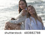 two pretty girls sitting on... | Shutterstock . vector #683882788