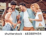 happy young friends partying on ... | Shutterstock . vector #683889454