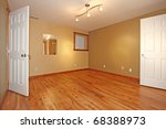 Green empty room without windows with two open inside doors. - stock photo