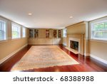 Luxury basement with upper windows, large old fire place and build-ins. - stock photo