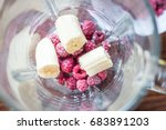 raspberries with banana in a... | Shutterstock . vector #683891203