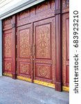 Small photo of Wood carving door traditional Uzbek pattern, claret color with golden inserts.