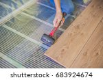 man installing new wooden... | Shutterstock . vector #683924674