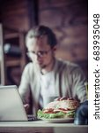 freelancer typing with one hand ... | Shutterstock . vector #683935048