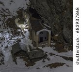 Small photo of Soana Valley, Piedmont, Italy - January 2015: Nocturnal view of the sanctuary of San Besso, built under a rocky cliff in 17th century.
