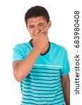 Small photo of tired teenage boy feeling pain amd putting his hands on mouth, teenager wearing blue t-shirt, isolated on white background