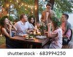 people having dinner in garden | Shutterstock . vector #683994250