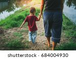 the boy walks hand in hand with ...   Shutterstock . vector #684004930