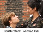 man trying to kiss woman  | Shutterstock . vector #684065158