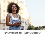 beautiful woman using mobile in ... | Shutterstock . vector #684065890