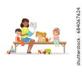 teacher reading a book to kids... | Shutterstock .eps vector #684067624