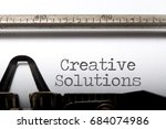 creative solutions printed on a ... | Shutterstock . vector #684074986