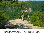 woman hiker standing at an... | Shutterstock . vector #684084136