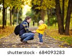 father and his toddler son... | Shutterstock . vector #684093283