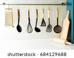 kitchen utensils haning from a