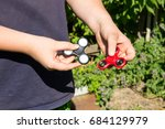 boy playing with two fidget...   Shutterstock . vector #684129979