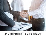 engineers shaking hands... | Shutterstock . vector #684140104