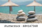 two pebble towers with sun... | Shutterstock . vector #684167368