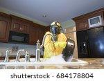 mature woman in yellow haz mat... | Shutterstock . vector #684178804