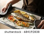 woman holding tray with baked... | Shutterstock . vector #684192838
