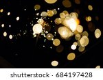 glowing sparks in the dark | Shutterstock . vector #684197428