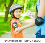 mother spraying insect... | Shutterstock . vector #684271600