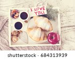 coffe and croissant on a tray | Shutterstock . vector #684313939