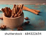 wooden bowl with cinnamon... | Shutterstock . vector #684322654