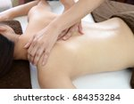 woman getting a body massage | Shutterstock . vector #684353284