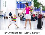 family at airport before flight.... | Shutterstock . vector #684353494