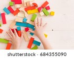 top view on child's hands... | Shutterstock . vector #684355090
