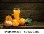 still life orange juice on... | Shutterstock . vector #684379288