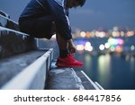 a guy tying running shoe ... | Shutterstock . vector #684417856