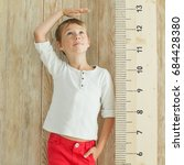measuring the growth of a child | Shutterstock . vector #684428380