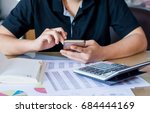 close up hand woman calculating ... | Shutterstock . vector #684444169
