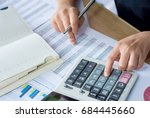 woman hand using calculator and ... | Shutterstock . vector #684445660